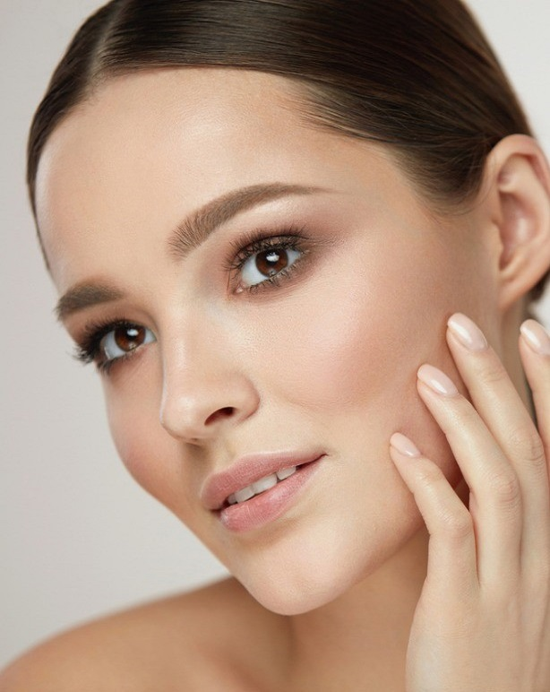 cosmetic-face-care-young-woman-caressing-facial-skin-picture-id956518824 (1)